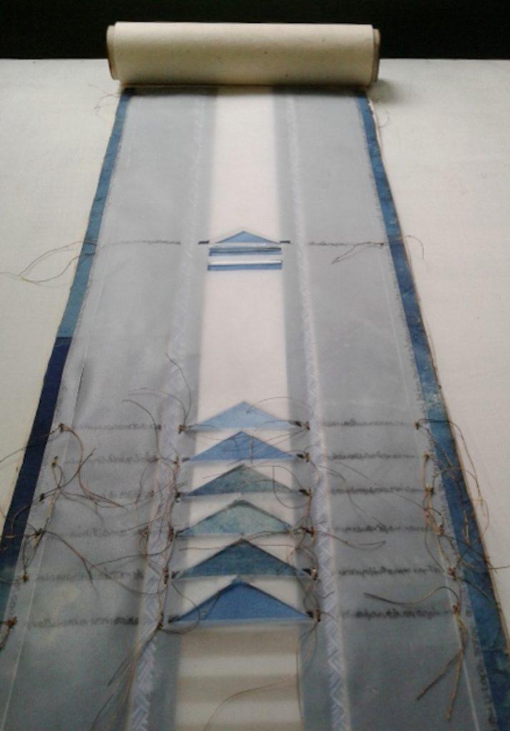 <i>Trips and stripes</i>, detail. Exhibition Afi.gr, Krebsen gallery, Kopenhagen, 2015 Handmade cotton paper, transparent paper, natural indigo dye, metal thread ,pencil.
