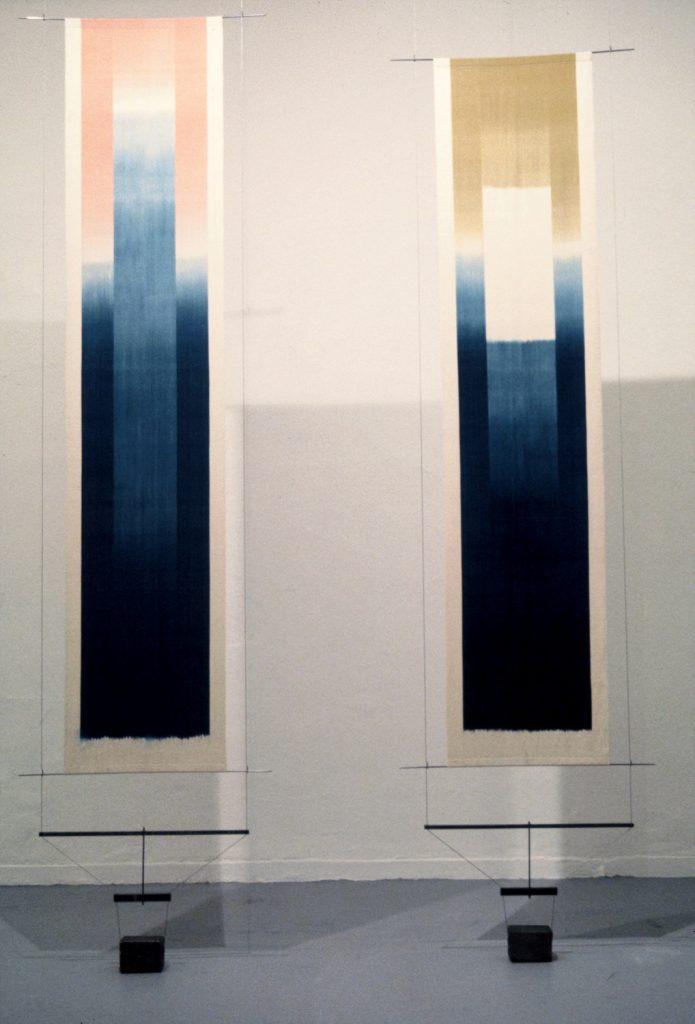 Uprise I and II, Hand woven cotton, warp ikat dye, natural dyes, indigo, madder, rust.                           Exhibition Afi at Patras, Epikentro, Patras 1992, exhibition  Weavings, Benaki museum 2020