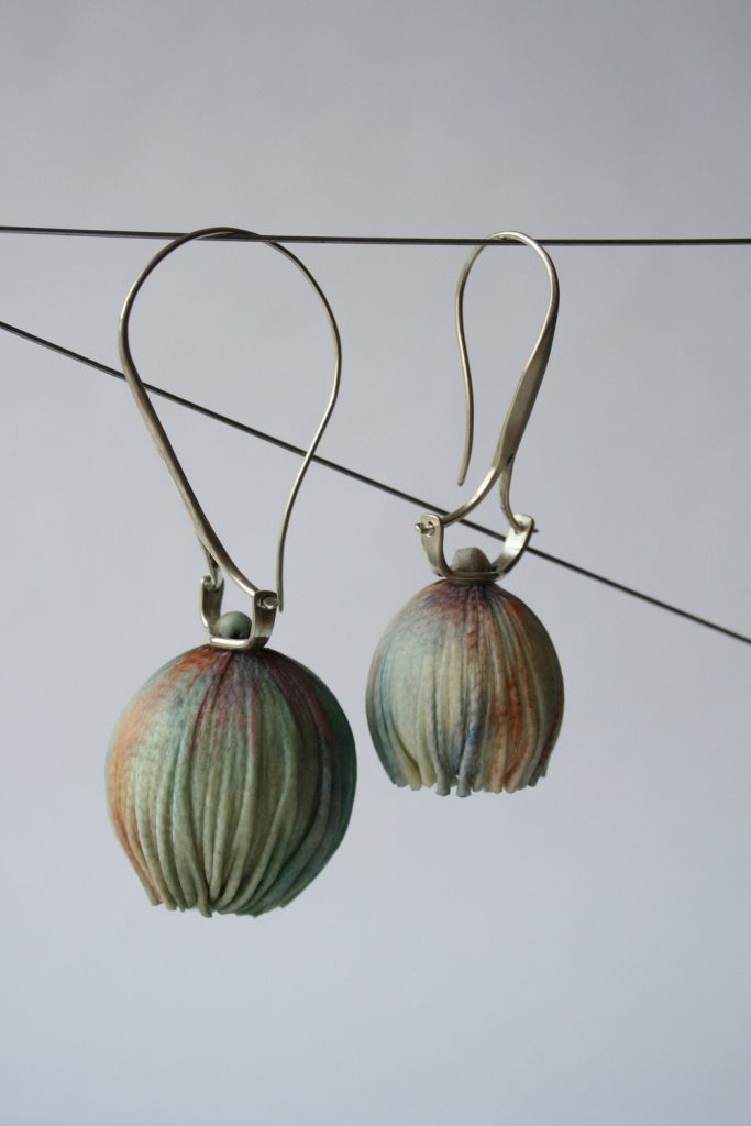Earrings: colored leather, forged silver
