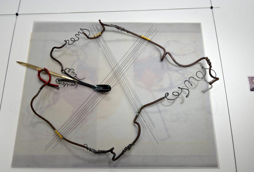 """The double- edged spoon"" : installation, Iron , magnet, bronze, steel rod"