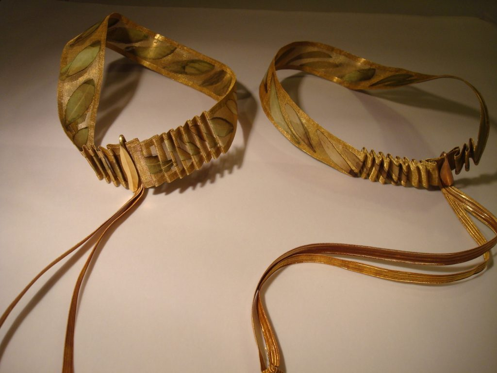 """""""Wedding wreaths"""":  bronze mess, pressed olive leaves, bronze pin, 2011"""