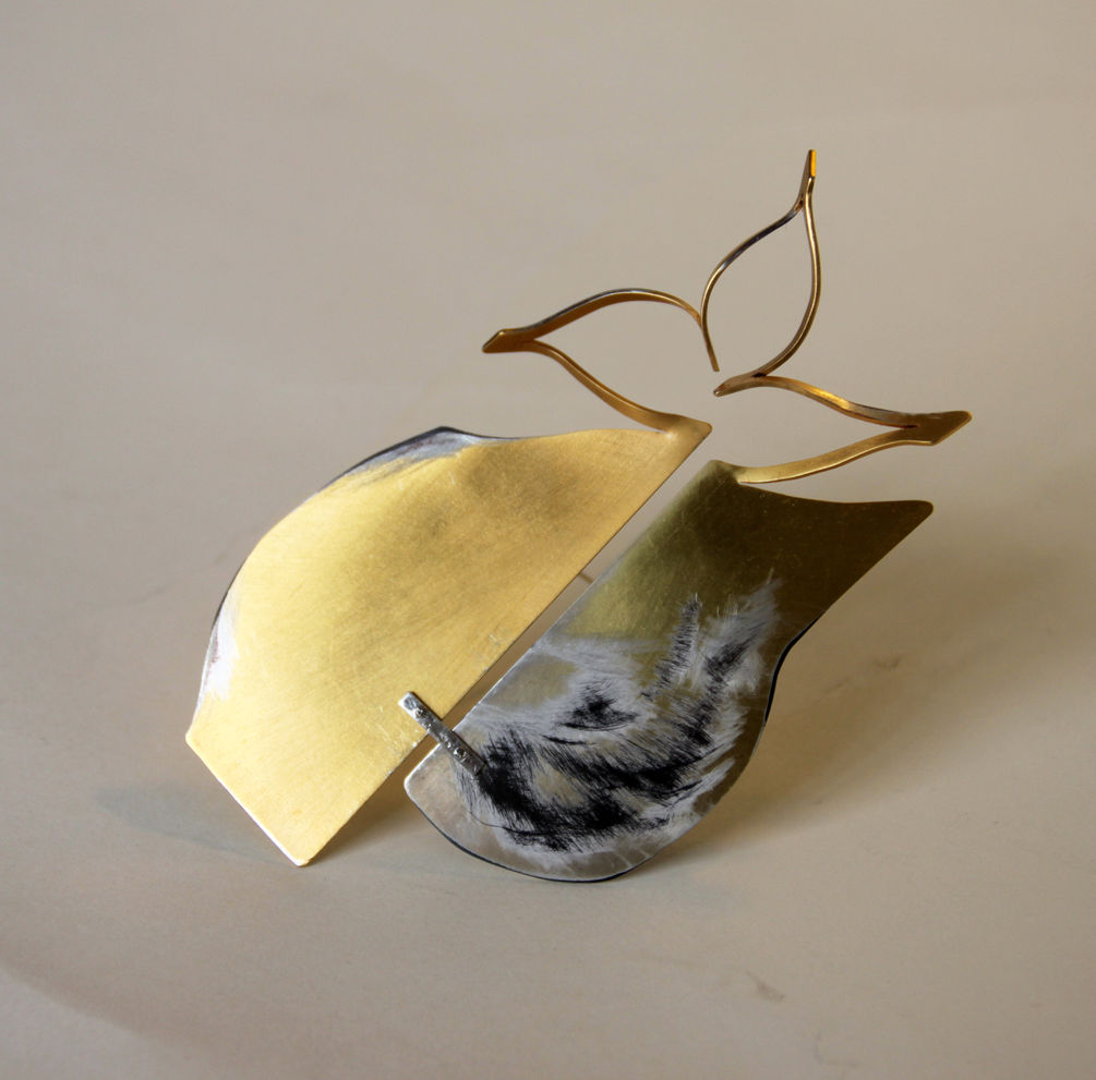 Brooches: hand fabricated iron , gold plated, fire oxydised
