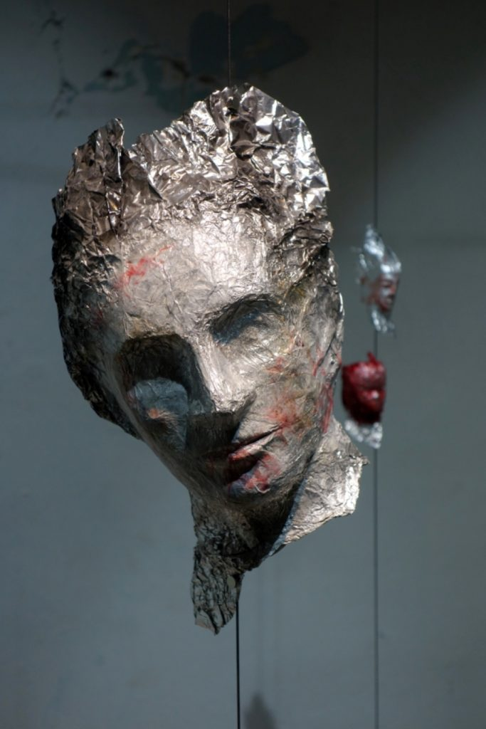 """The bliss of debauchery"" :   installation, aluminum foil, resin, acrylic colors"