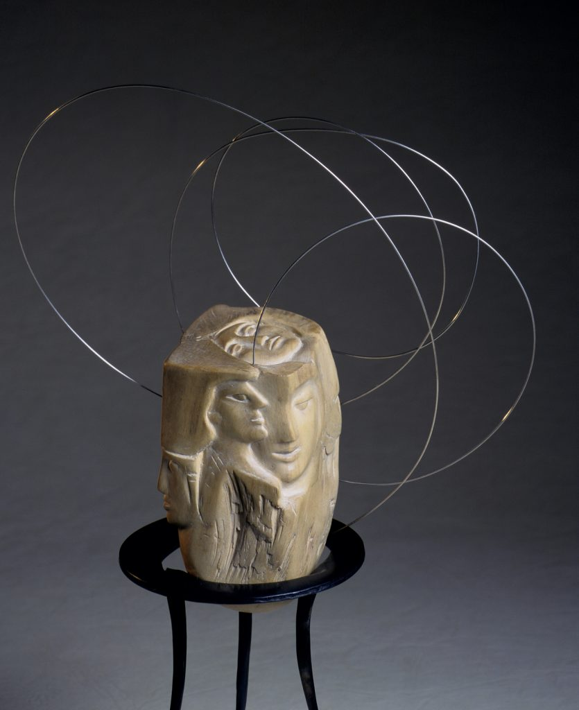 Carved wood, silver wire, iron tripod base