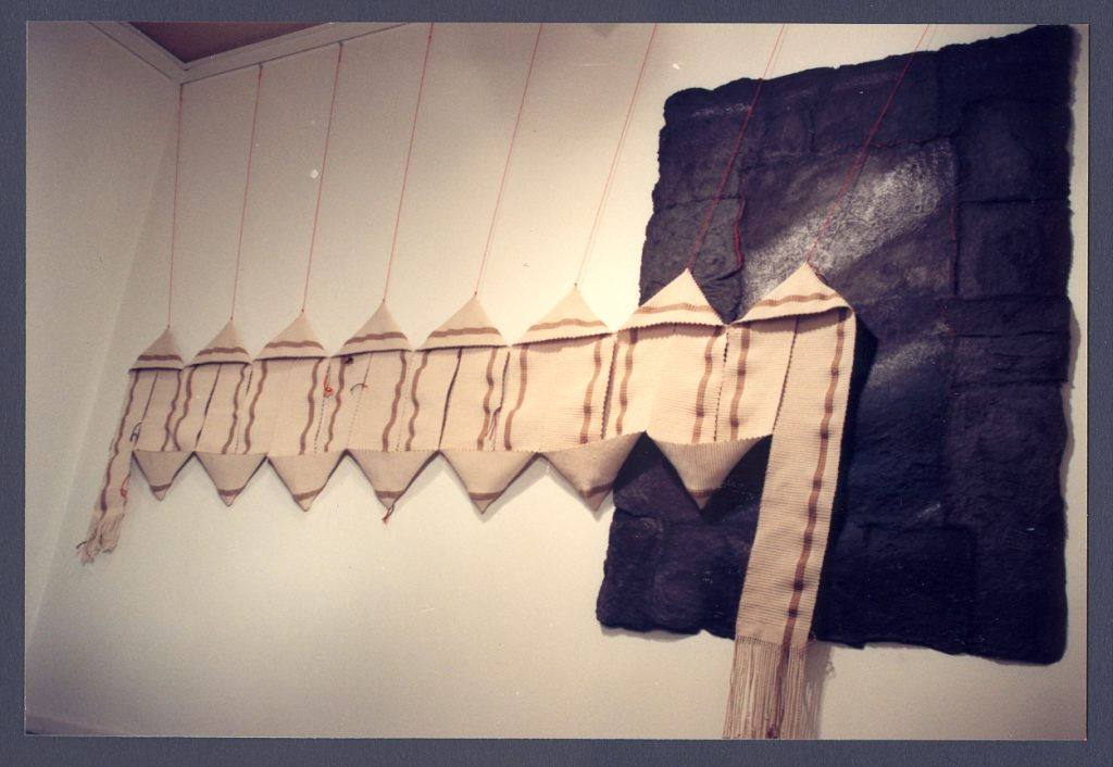 '' Light and Shadow '',   1991<br>Handmade paper, woven textiles<br>400 x 182 x 20 cm.