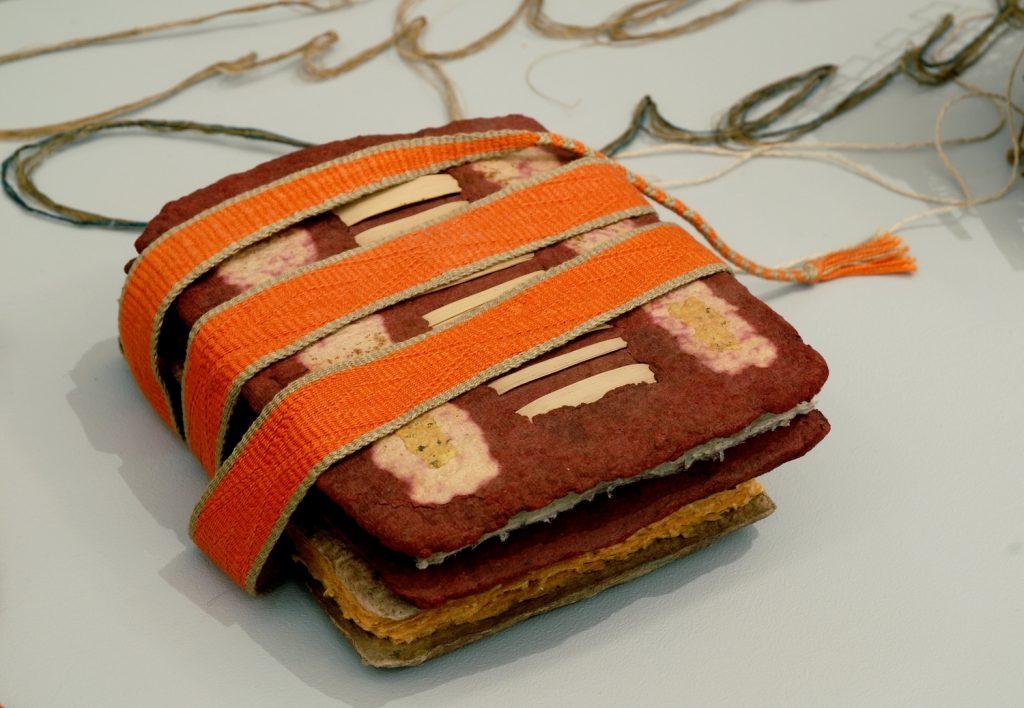 '' Bound Book '',   2009<br>Handmade paper, card woven belt<br>22 x 6 x 4 cm.