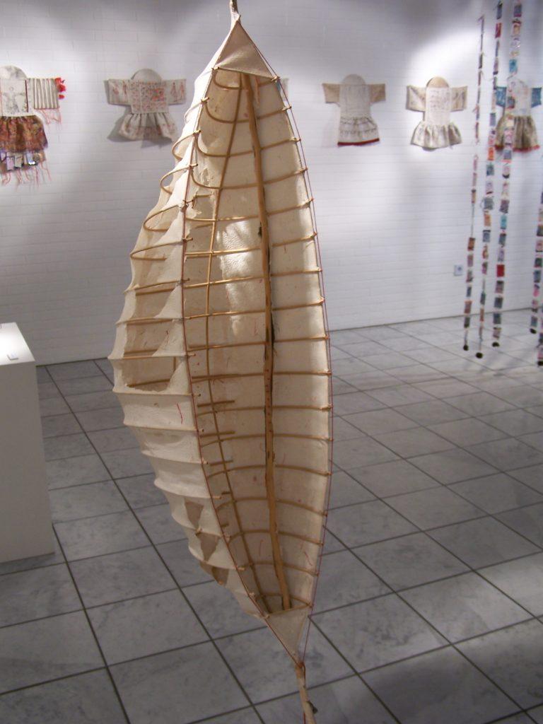 '' Shell '',   2003 <br>Handmade paper, rattan, wood<br>100 x 33 x 33 cm.<br>
