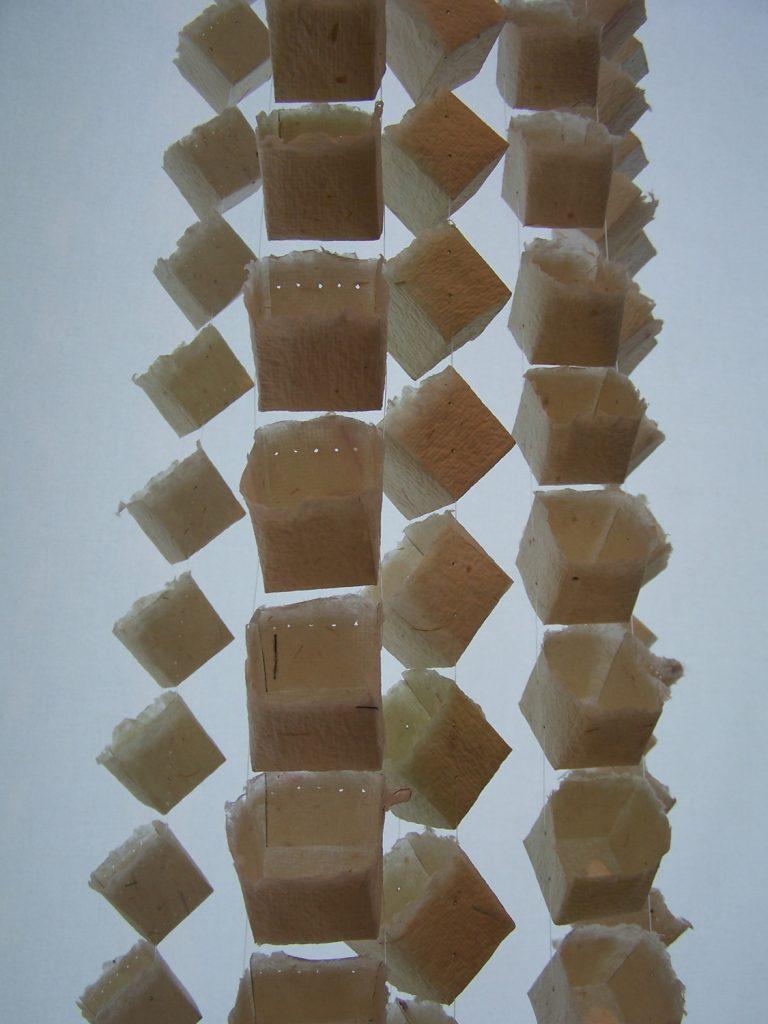 '' Rays '',   2014 <br>Handmade paper, nylon thread <br>300 x 80 x 80 cm.